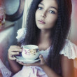 Girl with tea cup — Stock Photo