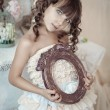 Girl with a vintage frame for photos — Stock Photo