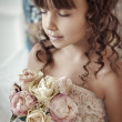 Stock Photo: Girl with a bouquet