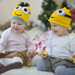 Babies near Christmas tree — Stock Photo #38332415