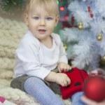 Baby near Christmas tree — Stock Photo #38332471