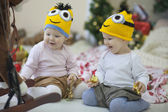 Babies near Christmas tree — Stock Photo