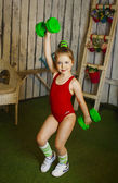 Little girl with dumbbells — Stock Photo