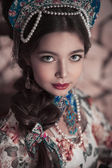 Girl in traditional russian clothes — Stock Photo