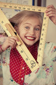Funny girl with ruler — Stock Photo