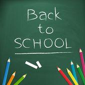Powrót do szkoły, napisany na tablicy — Wektor stockowy