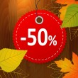 Autumn discount sale vector label on wood background — Stock Vector