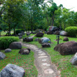 Tranquil garden. selective focus on the stone path — Photo