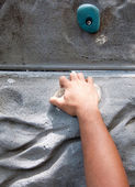 Hand hold grasping onto a wall climbing — Stock Photo