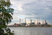 Tree and Oil refinery factory at river Thailand — Stock Photo