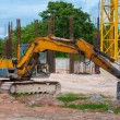 Excavator construction equipment park at worksite. — Stock Photo