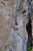 Woman climbing on the rock route summer — Stock Photo