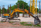 Excavator construction equipment park at worksite. — Stock Photo