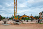 Excavator construction equipment park at worksite and Cement mix — Stock Photo