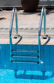 Swimming pool with stair at sport center — Stock Photo