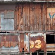 Stock Photo: Old wooden house wall and decay zinc window