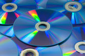 Colorful compact discs set of DVD scattered on a table — Fotografia Stock
