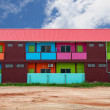 Stock Photo: Colorful houses on vacant land