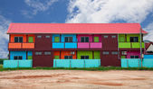 Colorful houses on vacant land — Stock Photo