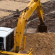 Excavator construction equipment park at worksite — Stock Photo #34880523