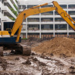 Excavator construction equipment park at worksite — Stock Photo #34889885