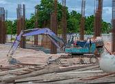 Excavator construction equipment park at worksite — Stock Photo