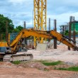 Excavator construction equipment park at worksite — Stock Photo #34897659
