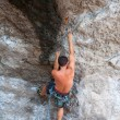 Man climbing on the rock route summer — Stock Photo