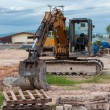 Excavator construction equipment park at worksite — Stock Photo #34916547