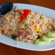 Stock Photo: Pork fried rice on table