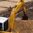 Excavator construction equipment park at worksite — Stock Photo #34932939