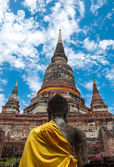 Behind the buddha statue and old temple in Thailand — Stock Photo