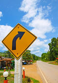 Turn right sign and street — Stock Photo