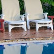 Swimming pool and lounge chair — Stock Photo #39816745