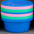 Colorful plastic basket in market — Stock Photo