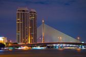 Night scene in Rama8 bridge and building. Bangkok,Thailand. — Stock Photo
