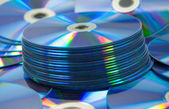 Colorful compact discs set of DVD scattered on a table — Stock Photo