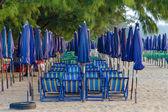 Umbrellas and beach beds — Stock Photo