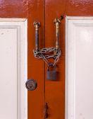 Master key on wood door and key knob — Stock Photo