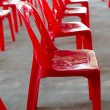 Red plastic chair — Stock Photo #39820861