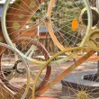 Bicycle wheels pattern decorate to background — Stock Photo