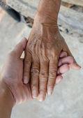 Holding hand Senior old women — Stock Photo
