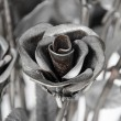 Flowers roses made of iron for Love is hard — Stock Photo