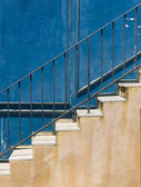 Old staircase and dirty metal wall — Stock Photo
