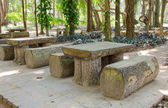 Wooden table set in the garden — Stock Photo