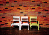 Three chairs with beautiful red brick wall background — ストック写真