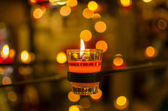 Burning candles bokeh blured background. — Stock Photo