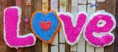 Spell the word LOVE made  from candle drippings colorful — Stock Photo