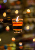 Burning candles bokeh blured background — Stockfoto