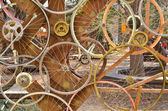 Bicycle wheels pattern decorate to background. — Stock Photo